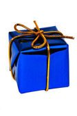 Small dark blue gift with a golden ribbo — Stock Photo