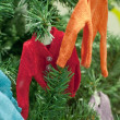 Toy clothes on a fur-tree — Stock Photo
