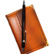 图库照片: Pencil on pocket-book
