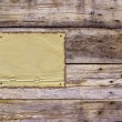 Royalty-Free Stock Photo: Burnt paper and weathered planks