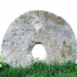 Old millstone — Stock Photo