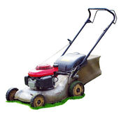 Lawn mower on green grass — Stock Photo