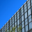 Stock Photo: Office building and blue sky