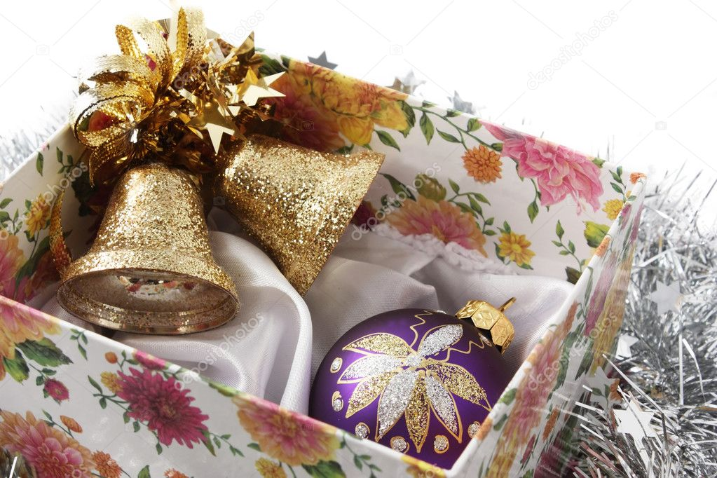 Christmas handbells and fir-tree toy in a box — Стоковая фотография #1277614