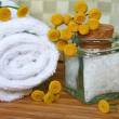 White bath towel, bottle of sea salt in — Stock Photo #1143547