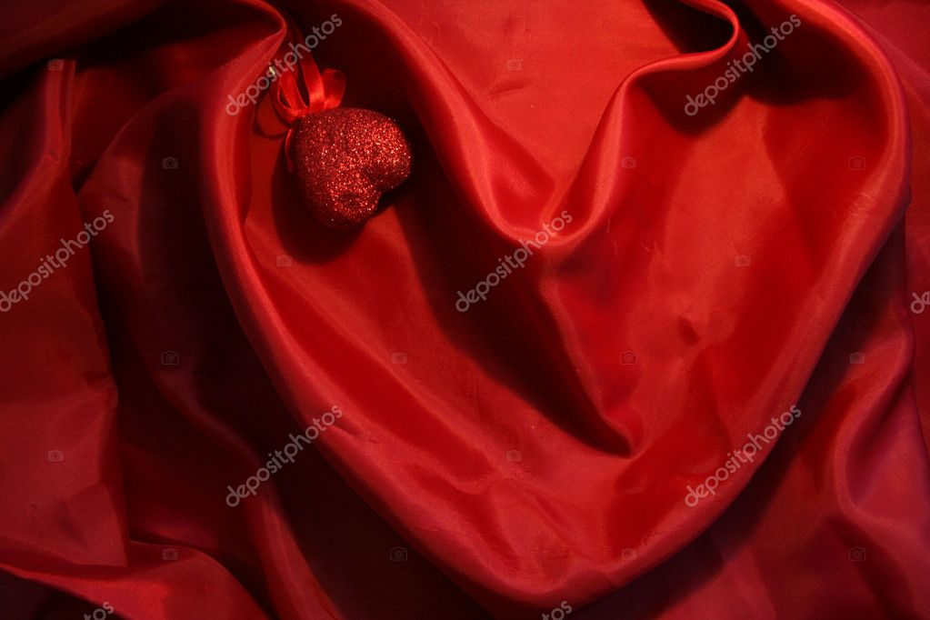 Red heart from elegant red silk for St Valentine's day background — Stock Photo #1144046