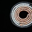 Circle of white, black and pink pearls o — Stock Photo