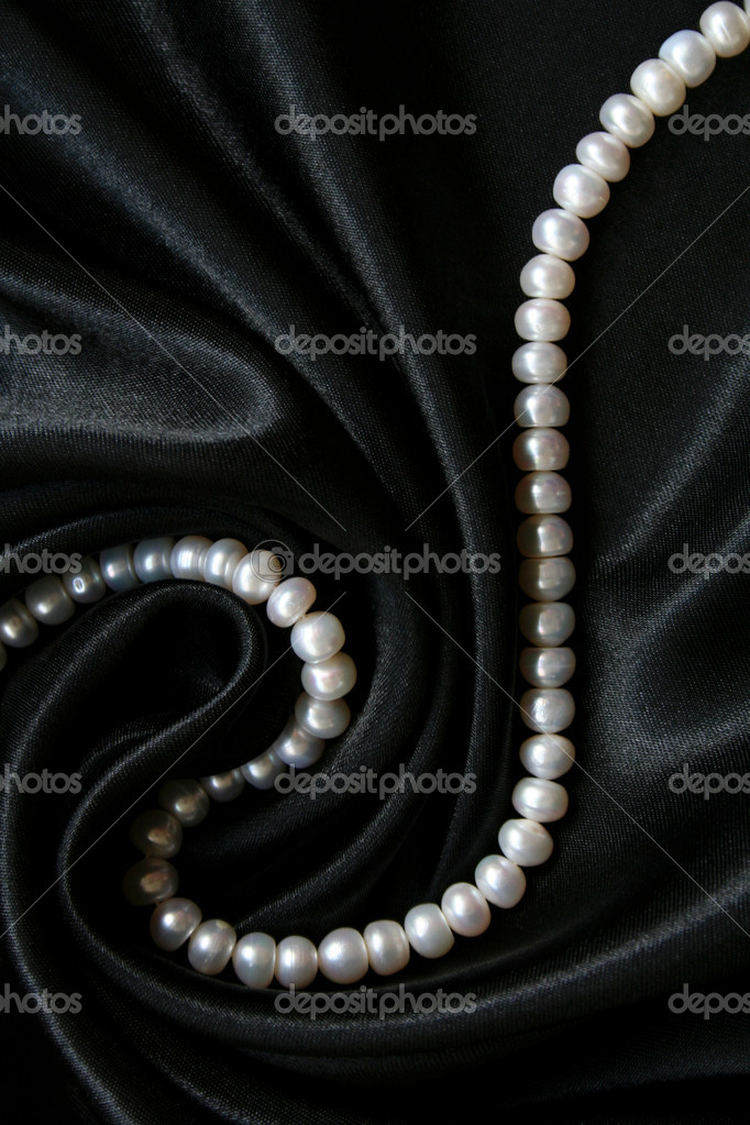White pearls on the black silk can use as background  — Stock Photo #1181309
