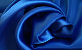 Smooth elegant blue silk as background — Stock Photo
