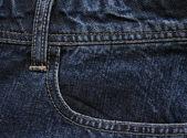Pocket från en blå jeans tyg som backg — Stockfoto