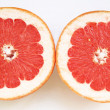 Grapefruit halves close-up on the white - Stock Photo