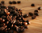 Heap of burnt brown arabica coffee beans — Stock Photo