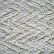 Stock Photo: White knitted fabric as background