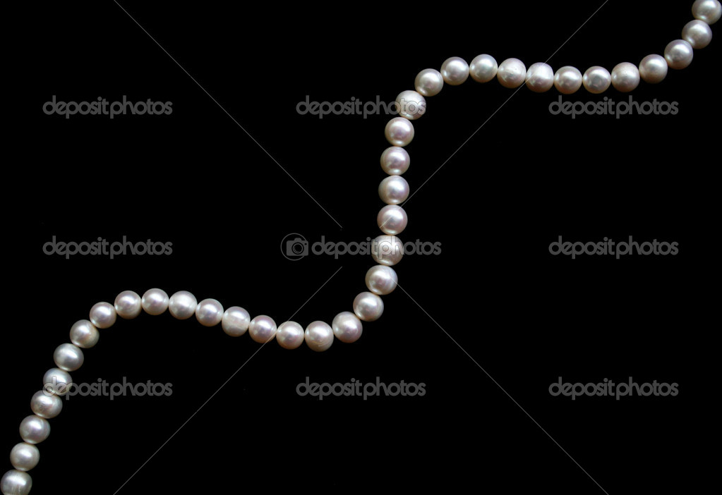 White pearls on the black silk can use as background  — Stock Photo #1267429