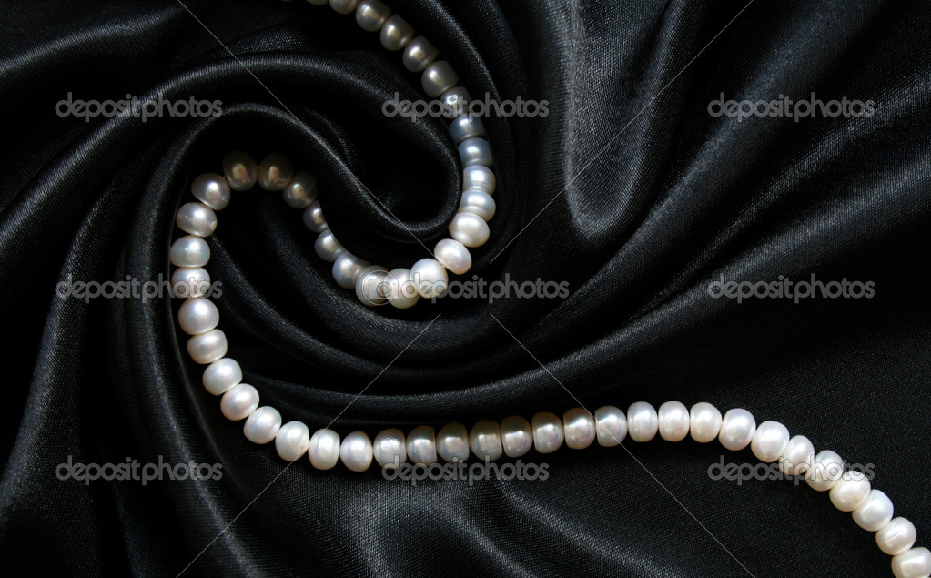 White pearls on the black silk can use as background — Стоковая фотография #1275185
