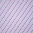 Pink strips on the fabric as background - Stock Photo