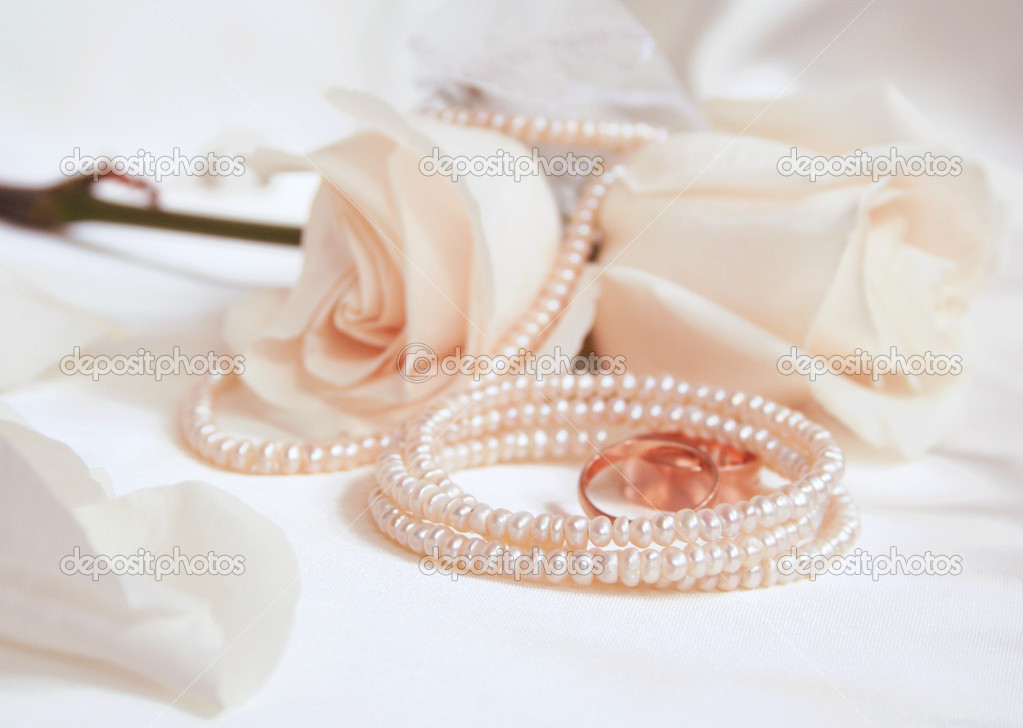 Wedding rings and roses as wedding background   Stock Photo #1583308