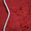 White pearls on a terracotta velvet — Stock Photo #1739118