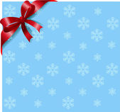 雪花背景上的红丝带 — 图库矢量图片
