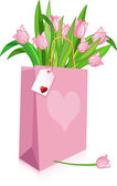 Pink Tulips in a bag — Stockvector