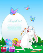 Easter Bunny painting Easter Eggs — Stock Vector