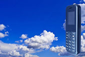 The Mobile telephone, on background sky. — Stock Photo