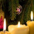 Three burning candles, on background, ated, new year's toy, removed close-up. — Stock Photo #1375641