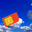 Sim card on background sky. — Stock Photo