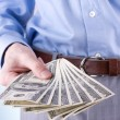 Money in the hand of the businessman — Stock Photo