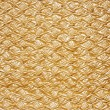 Golden textured oilcloth or leather — Stock Photo