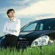 Successful businessman with car — Stock Photo