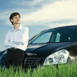 Stock Photo: Successful businessman with car