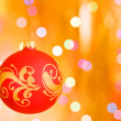 Stock Photo: Christmas ornaments over gold background