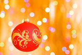 Christmas ornaments over gold background — Stock Photo