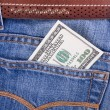 Hundred dollar bill in pocket of jeans — Stock Photo