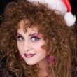 Beautiful curly-headed Santa-girl — Stock Photo