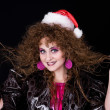 Beautiful curly-headed Santa-girl - Stock Photo