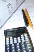 Calculator on document — Stock Photo