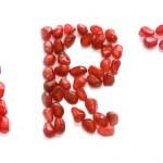 sztuka słowa listów czerwony granat — Zdjęcie stockowe #1161520
