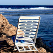White deck chair on clean beach — Stock Photo