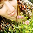 Stock Photo: Young lady on meadow
