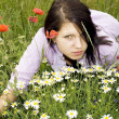 Pretty brunette on summer meadows — Stock Photo