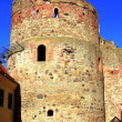 Stock Photo: Old tower castle in town Bauska