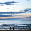 Stock Photo: Two silhouettes ashore Baltic sea