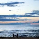 Two silhouettes ashore the Baltic sea — Stock Photo #1294765