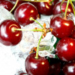 Fresh juicy cherry in ice — Stock Photo