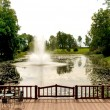 Fountain on the river — Stock Photo