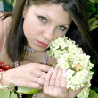 Beautiful lady with a hydrangea — Stock Photo