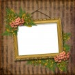 Picture gold frame with a decorative pat — Stock Photo