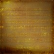 Grunge musical background with gold note — Stock Photo